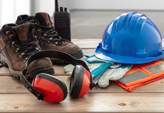 Image of construction worker tools and safety helmet